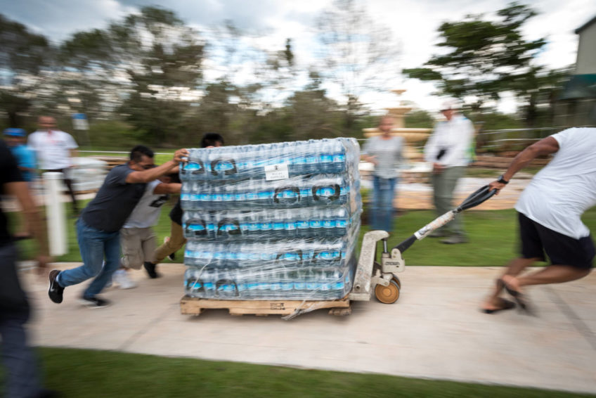 Volunteers unload Hurricane Irma relief supplies at Bethel Assemblies of God Church in Immokalee, Fla. Sept. 13. Along with World Vision staff, they distributed the supplies to residents affected by the storm. (©2017 World Vision/photo by Eugene Lee)