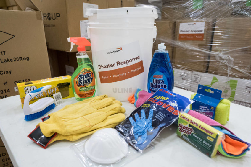 The contents of a storm clean-up kit include gloves, cleaning chemicals, scrub brushes, and other items. (©2017 World Vision/photo by Eugene Lee)
