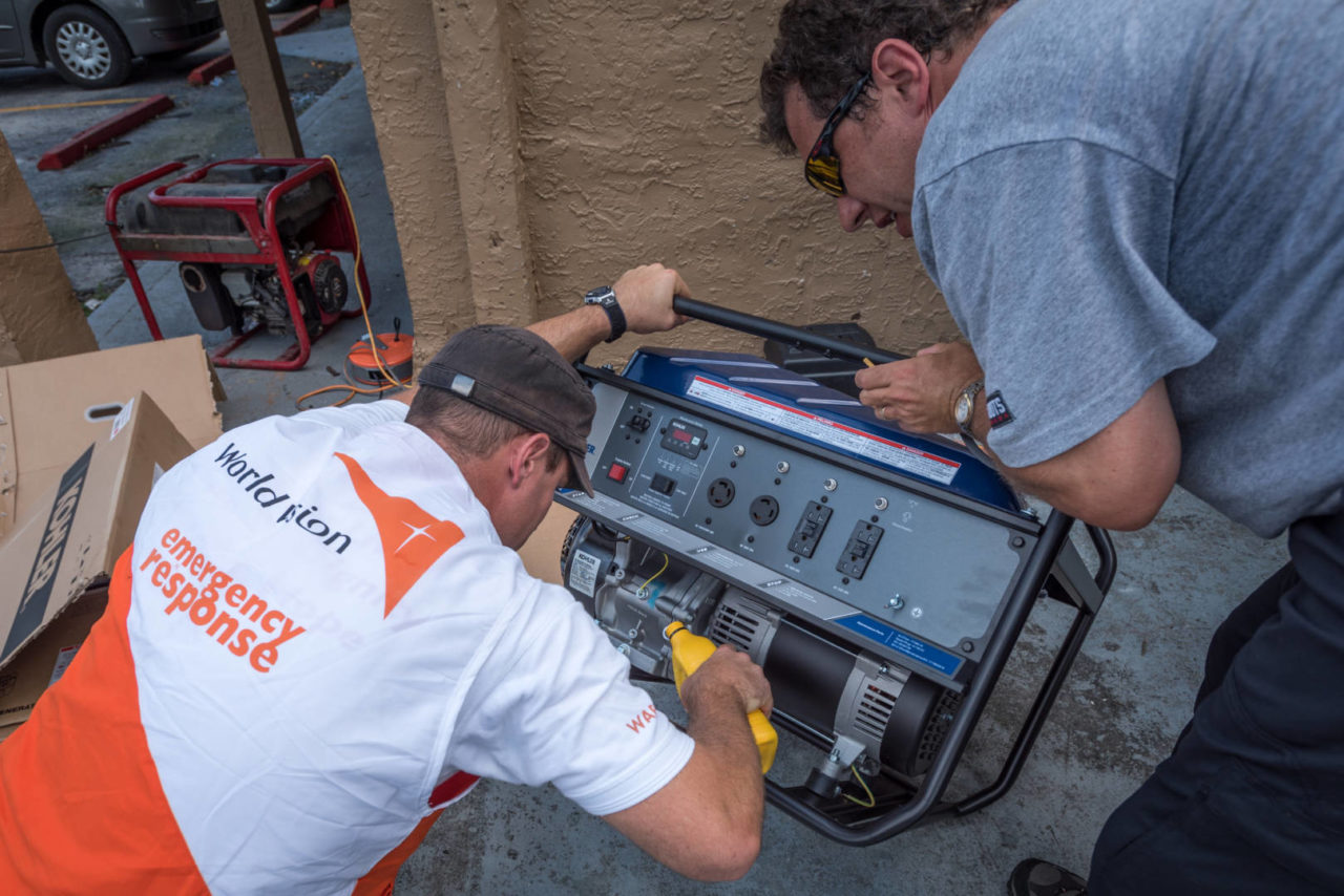 World Vision's James Orlando and Mike Weickert setup a generator at Mision Peniel in Immokalee, Florida.