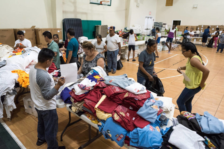 Families affected by Hurricane Irma gather World Vision relief supplies Sept. 14 at Bethel Assemblies of God Church in Immokalee, Fla. (©2017 World Vision/photo by Eugene Lee)