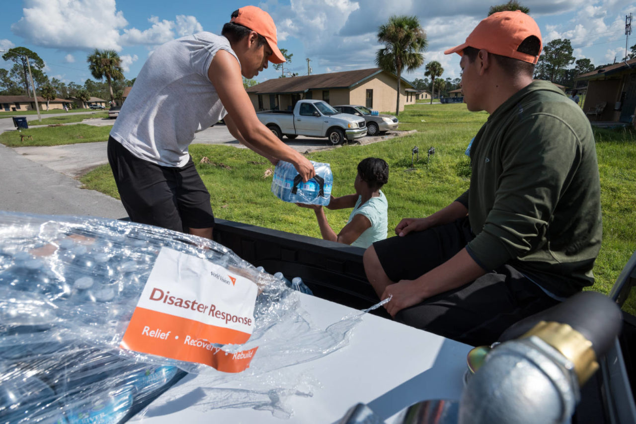 Bethel church volunteers distribute World Vision Hurricane Irma relief supplies at a farmworker village in Immokalee.