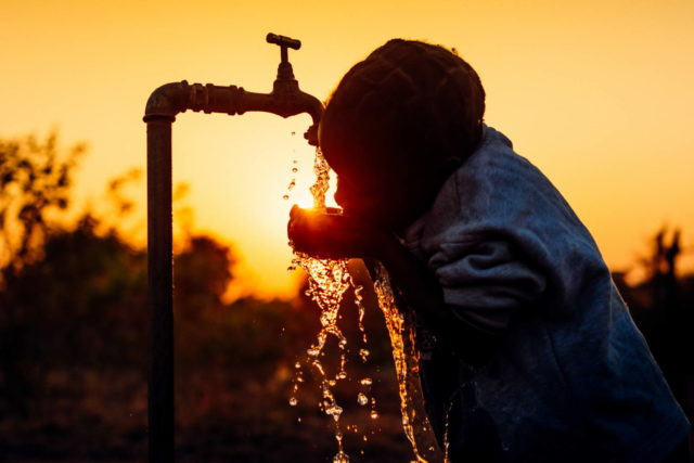 World Vision photographer Jon Warren searches for the right location and right moment to capture a great image of precious water in Zambia.