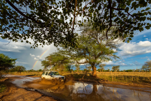 A rainbow appears behind a World Vision vehicle in Zambia.