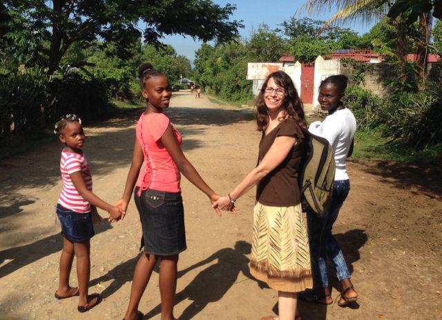 World Vision sponsor with her sponsored children in Haiti.