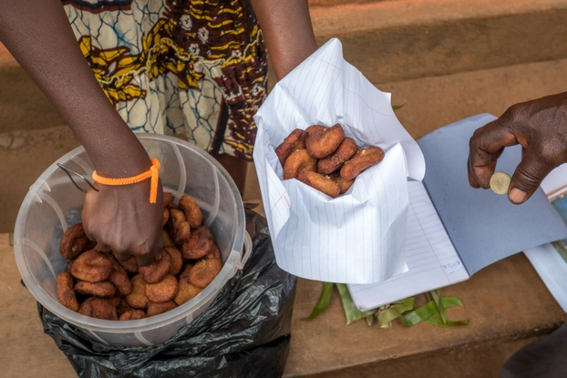 Josephine in Uganda makes 650 banana pancakes every Sunday and sells them at church for a penny each. She raises 13 children on that $6.50 a week.