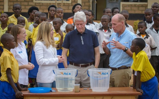 Former U.S. President Bill Clinton and daughter Chelsea got a personal look at the toll of unsafe water, as part of a visit to a primary school in Rwanda.