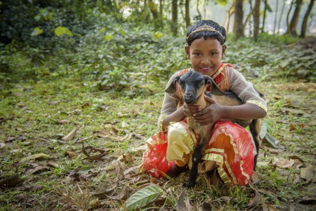 Sonali holds one of the goats her family received from World Vision.