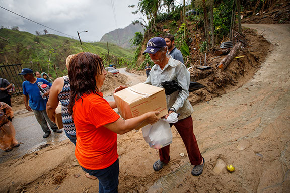World Vision and volunteers from church partner Calvary Church in Utuado, Puerto Rico, provided food, water, hygiene kits, and tarps to 32 families in Jayuya-area communities of Parceles Ponce and Paso Palma following Hurricane Maria. (©2017 World Vision/photo by Chris Huber)