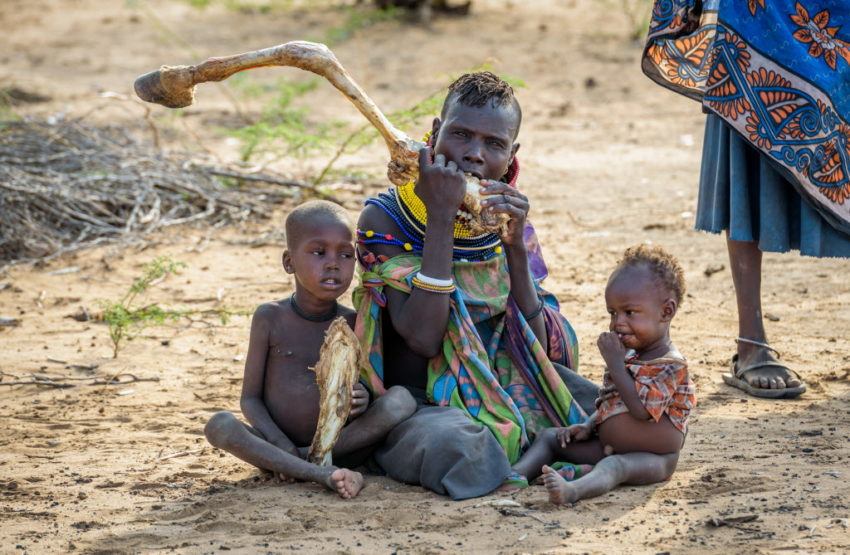 Mother and her children eating marrow from a donkey bone. The East Africa hunger and food crisis is one of the worst disasters of 2017.