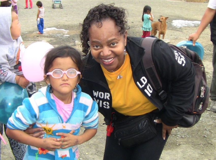 Rev. Belynda Gentry visits with children in Peru. (Photo courtesy of Belinda Gentry)