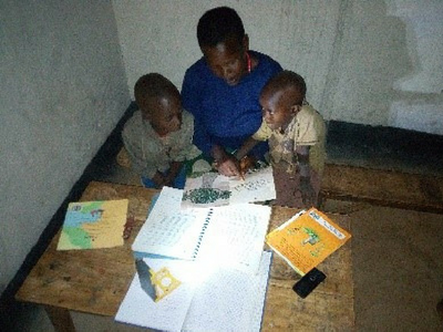 When children like Didier in Rwanda don't have electricity at home, practicing his reading at night becomes impossible, but solar lamps are helping to improve literacy!