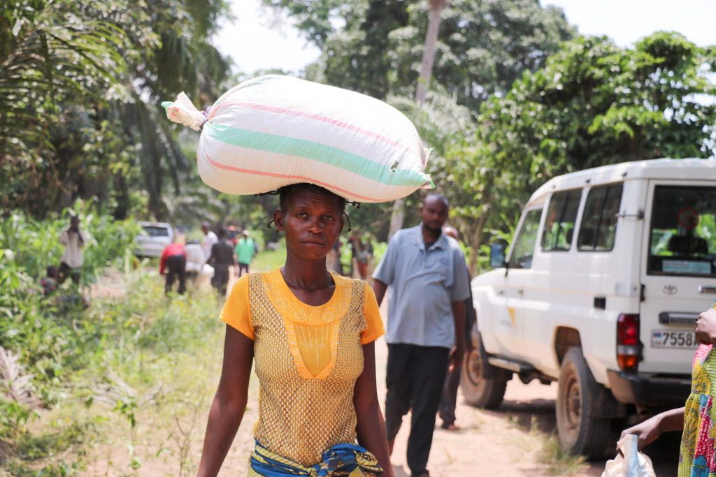 Woman carrying bag of food on her head in Democratic Republic of the Congo.