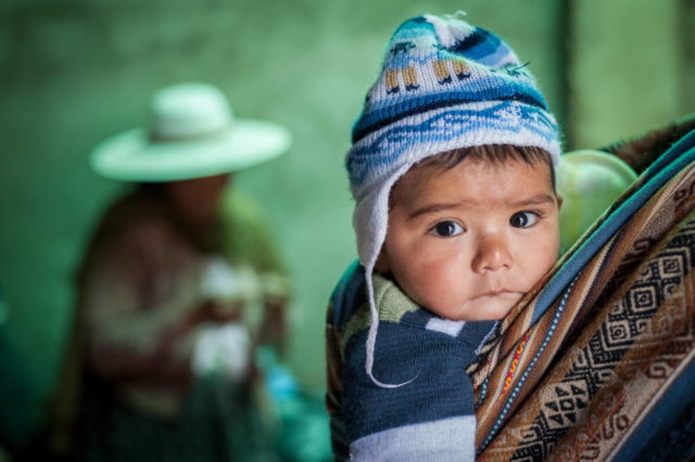 Baby on mother's back in Bolivia. Pray for South America.