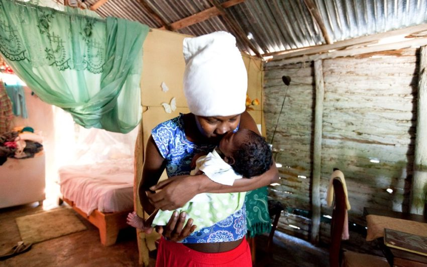 Woman holding baby in Haiti. Pray for the Caribbean.