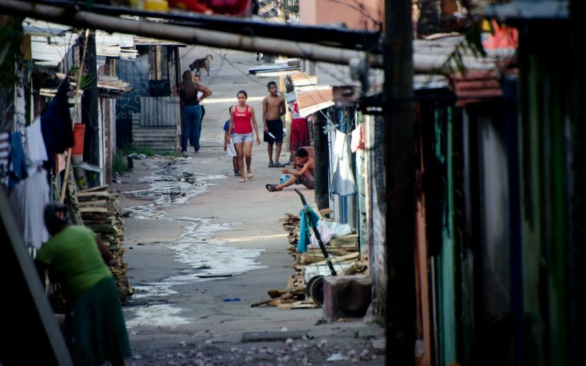 People walking in a street in El Salvador. Pray for Central America.