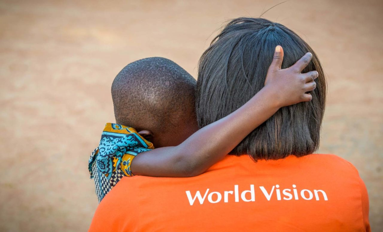 Elizabeth Aluka, area program manager in Morungatuny, Uganda, has an intimate talk with Grace (©2017 World Vision/photo by Jon Warren)