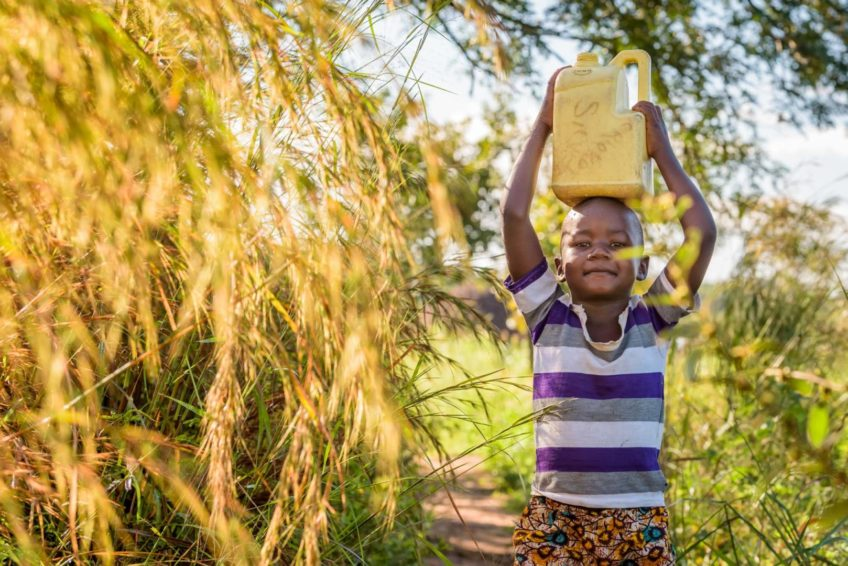 Grace, 5, walks about 6 kilomters every day to help provide dirty water for her family to use for drinking, washing, and cooking. She often misses school because it takes so much of her time. (©2017 World Vision/photo by Jon Warren)