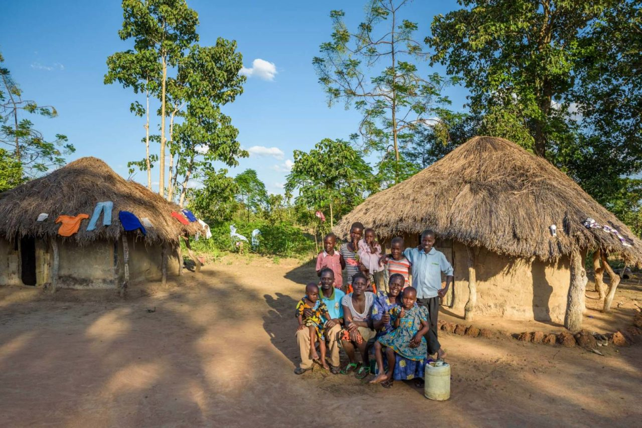 Grace and her family sit at their home. (©2017 World Vision/photo by Jon Warren)