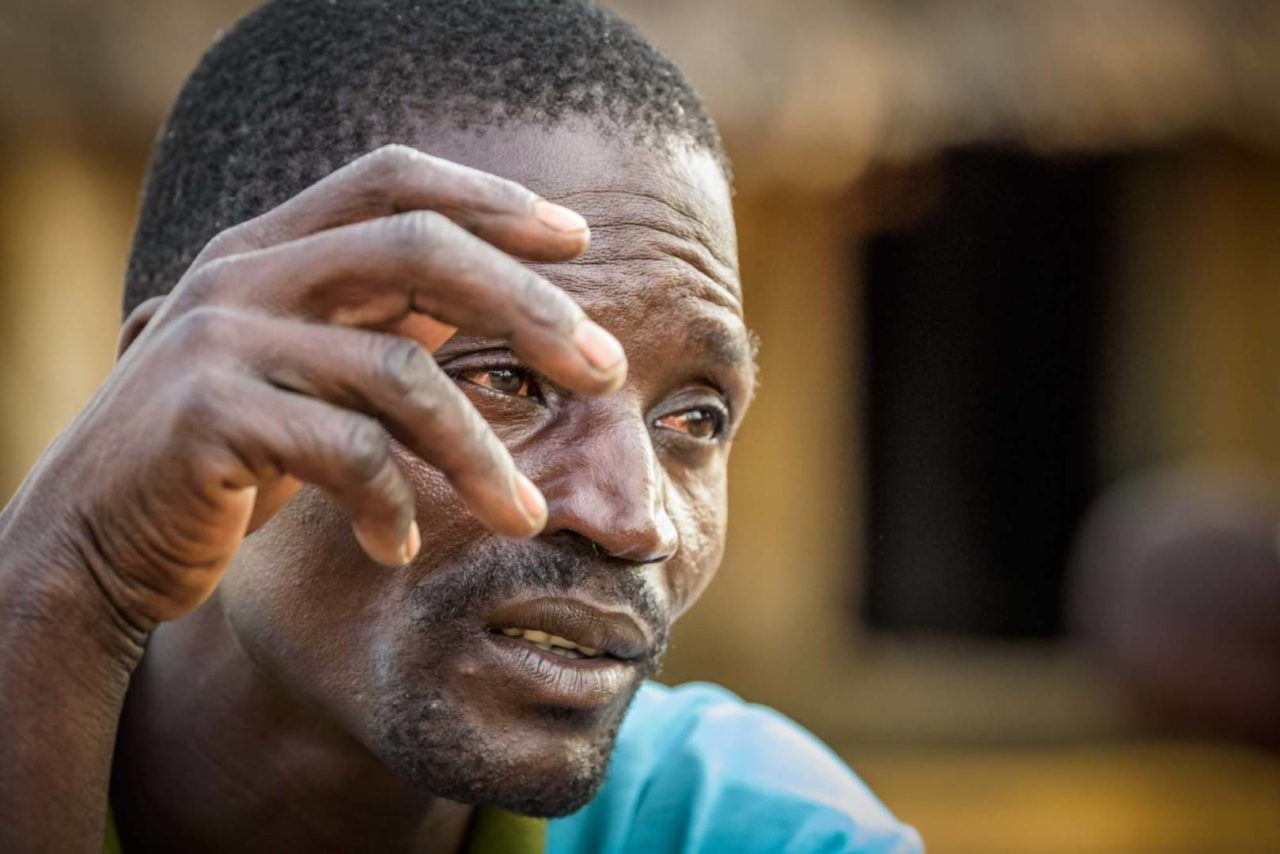 Grace's father, Alia Joseph, 35, still carries emotional and physical pain from being tortured by the Lord's Resistance Army. (©2017 World Vision/photo by Jon Warren)
