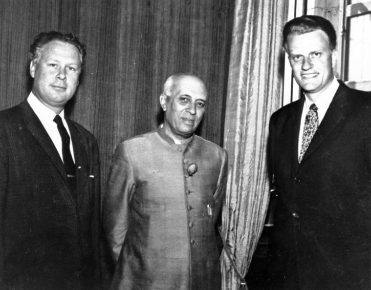 From left to right, World Vision founder Bob Pierce, India's Prime Minister Jawaharlal Nehru, and the Rev. Billy Graham pose for a photo. Graham met many world leaders during his work.