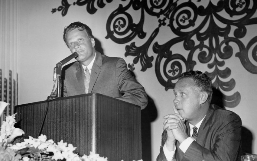Billy Graham (left) played an important role in the early years of World Vision. Alongside World Vision's founder Bob Pierce (right), he visited children's homes and preached to U.S. troops in Korea and later served as chair of the World Vision board.