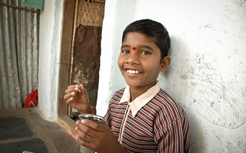 A boy takes his medicines to complete his course of treatment for TB.