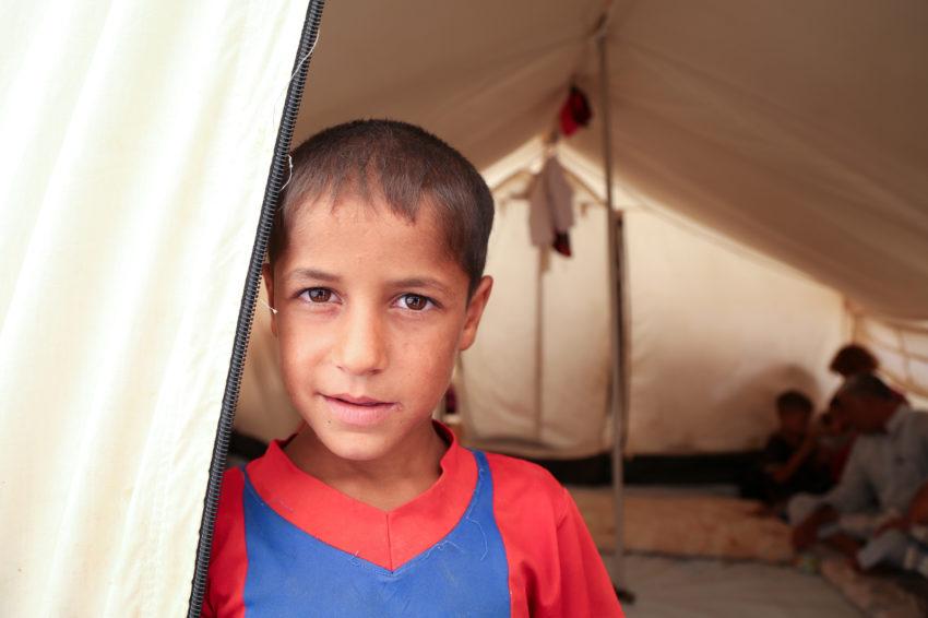 Iraq boy in tent camp