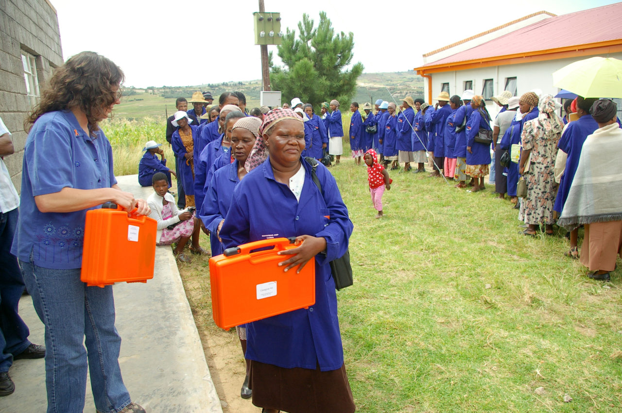 WVUS staff and donors distribute medical kits to caregivers in Lesotho. Seventeen churches in the areas have teams of caregivers. Each member is expected to take care of at least three chronically ill patients using their donated caregiver kit. (©2008 World Vision/photo by Makopano Setsatsi)