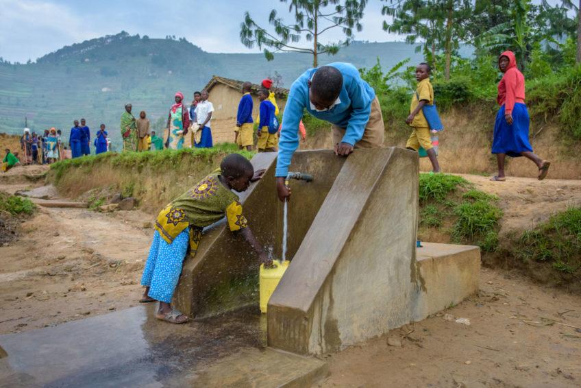 Rwanda kids with running water.