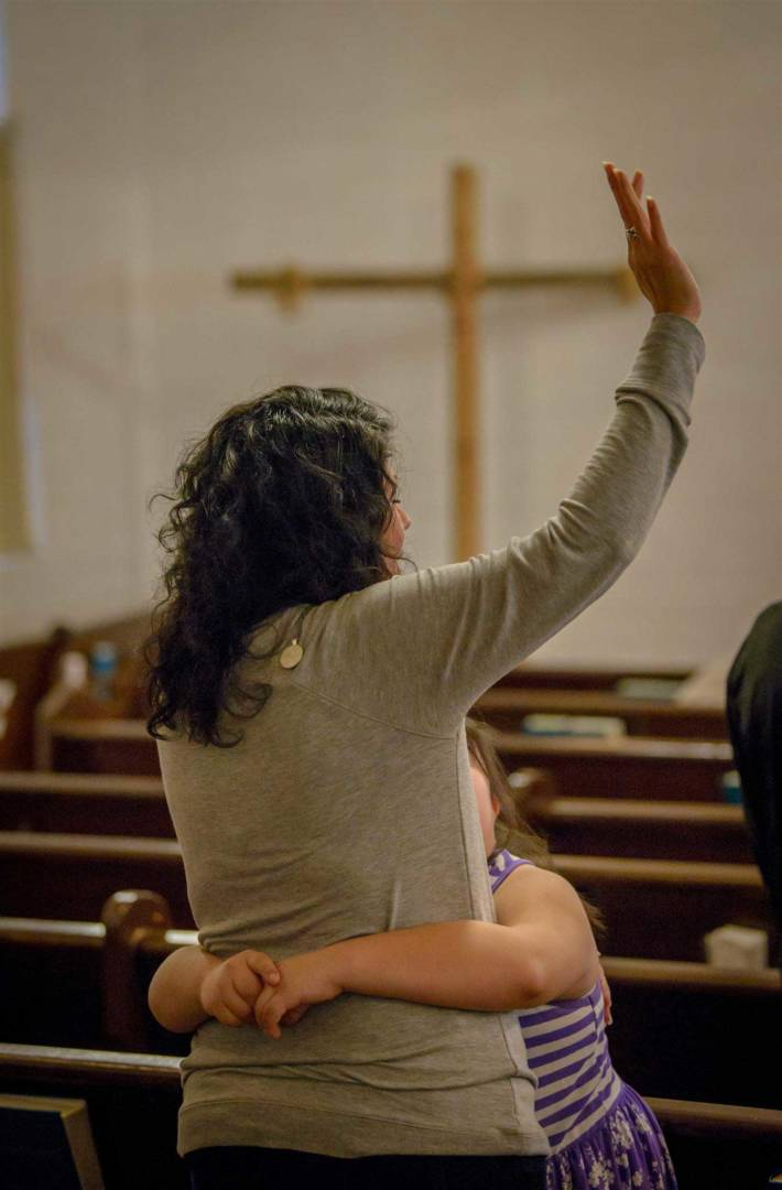 Nikki Garcia hugs her mother Veronica Garcia as she worships during the Sunday service at Faith Memorial Baptist Church in Houston on the Sunday following the devastation of Hurricane Harvey. The church served more than 1,000 people in the first week following the storm, in part with relief supplies provided by World Vision. (©2017 World Vision/photo by Laura Reinhardt)