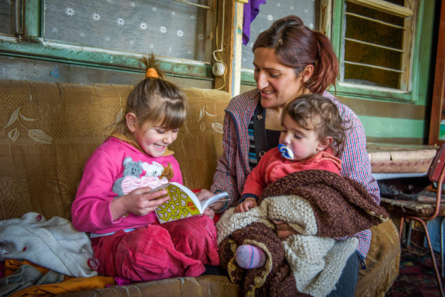 A family in Armenia reads together