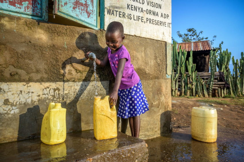 Young Kamama collects clean water from a World Vision kiosk in Kenya.