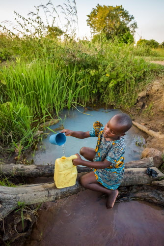 African girl fetching water - affected by global water crisis