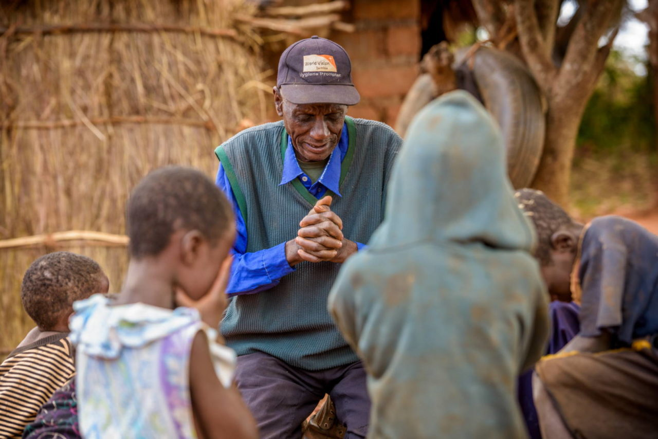 John Nalukobo, 74, reads the Bible and prays daily with the seven grandchildren he and wife Belita, 64, are raising.