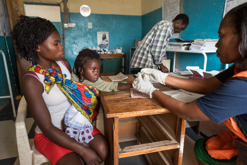 Bertha, 3, who has a cough, fever, diarrhea, and vomiting gets a malaria test at the Katunda Health Center in Luampa district, Zambia. (©2018 World Vision/ photo by Eugene Lee)