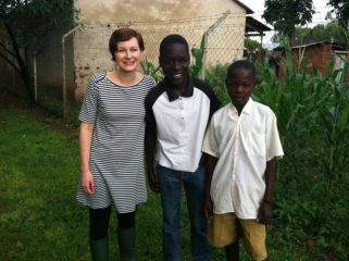 Rachael Boyer meeting her sponsored child and his brother in Uganda in 2011. Photo courtesy of Rachael Boyer.