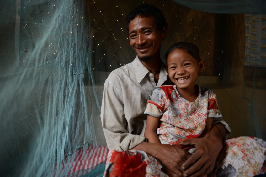 Ruthi Molsom, 5, and her father, Adinbokto Molsom, use bed nets since Ruthi was diagnosed with malaria at age 2. World Vision supplies bed nets, malaria medications, diagnosis tests, and information on how to prevent the disease to their community in India. (©2015 World Vision/photo by Annila Harris)