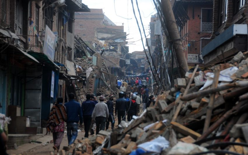 People walk among the ruins of buildings in Kathmandu three days after the April 25, 2015, Nepal earthquake. (©2015 World Vision/photo by Theodore Sam)