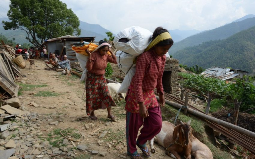 Women carry relief goods on their heads