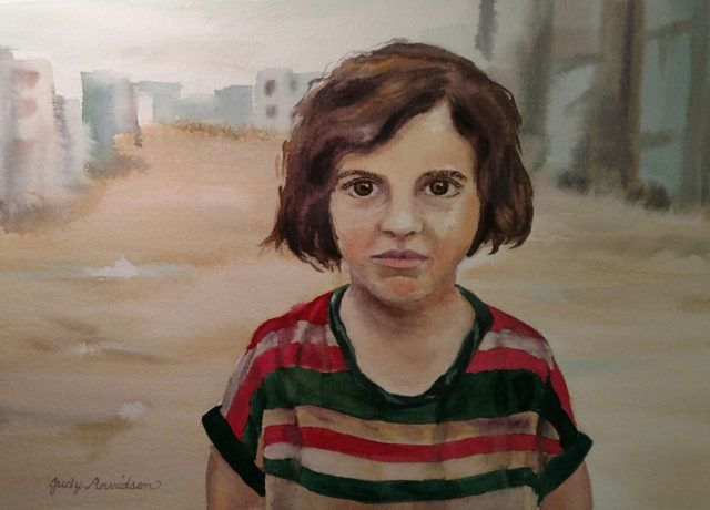 Syrian refugee girl standing in road in refugee camp.