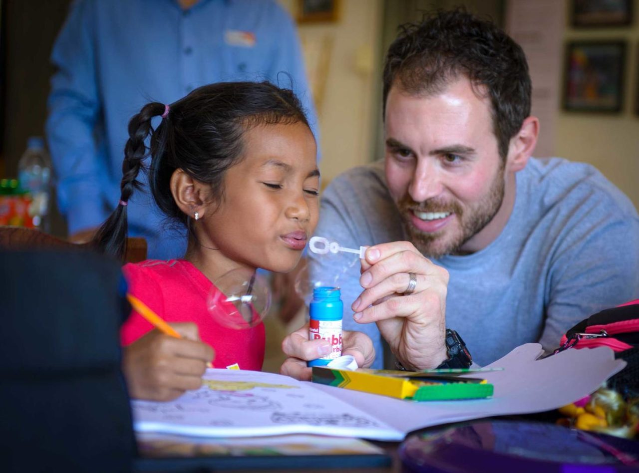 Brian Beihl, drummer for Big Daddy Weave, spends time with Srey Soa Sim, a sponsored child in Cambodia.