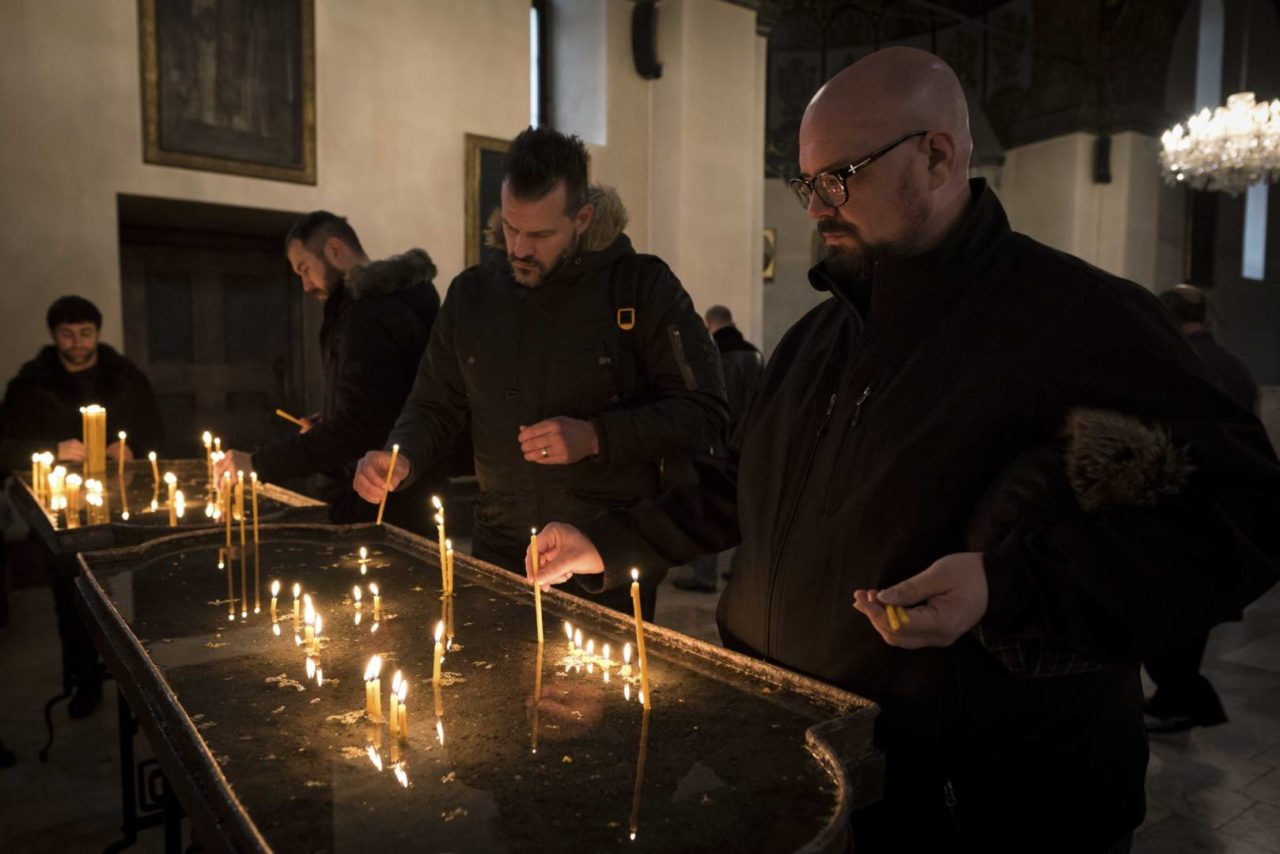 Big Daddy Weave band members (righ to left) Mike Weaver, Jeremy Redmon, and Brian Beihl light candles at Etchmiadzin Cathedral Armenian Apostolic Church in Vagharshapat, Armenia. According to scholars it was the first cathedral built in ancient Armenia (early fourth century — between 301 and 303), and is considered the oldest cathedral in the world.