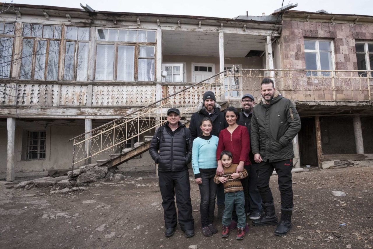 Big Daddy Weave band members (left to right) Joe Shirk, Brian Beihl, Mike Weaver, and Jeremy Redmon visit Hermine Mkhitaryan's family at their home in Tchambarak, Armenia.
