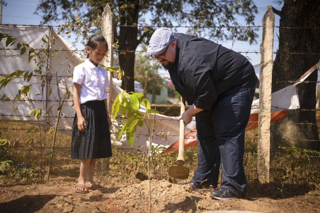 Mike Weaver, singer for Big Daddy Weave, plants a tree with his sponsored child, Kimhuoy Hak.
