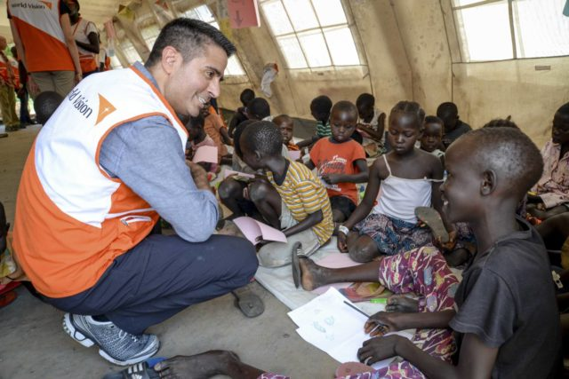 World Vision U.S. President-elect Edgar Sandoval meets with young South Sudanese refugees in a World Vision child-protection tent at a center in northern Uganda.