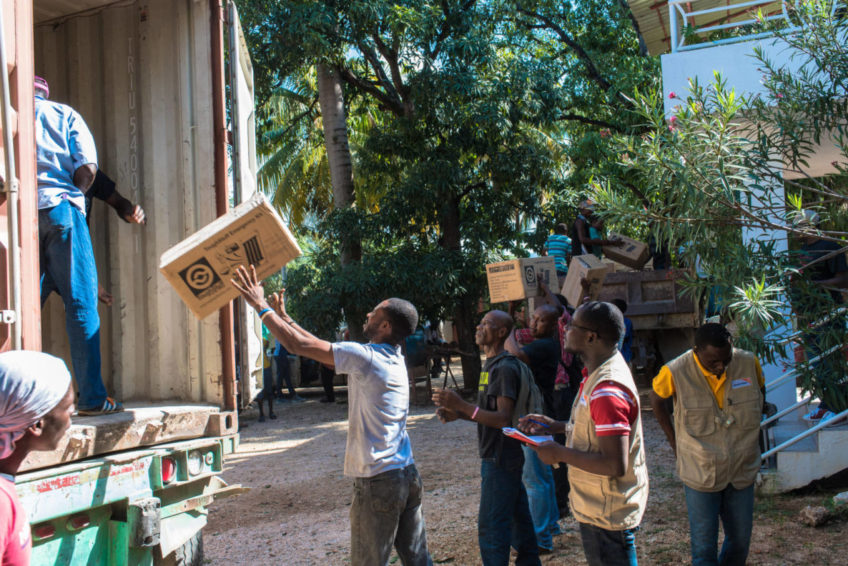 Boxes of relief goods arrive by truck in the coastal city of Miragoâne, the capital of Nippes in southwest Haiti, which was among the areas worst affected by Hurricane Matthew. (©2016 Guy Vital-Herne/World Vision)