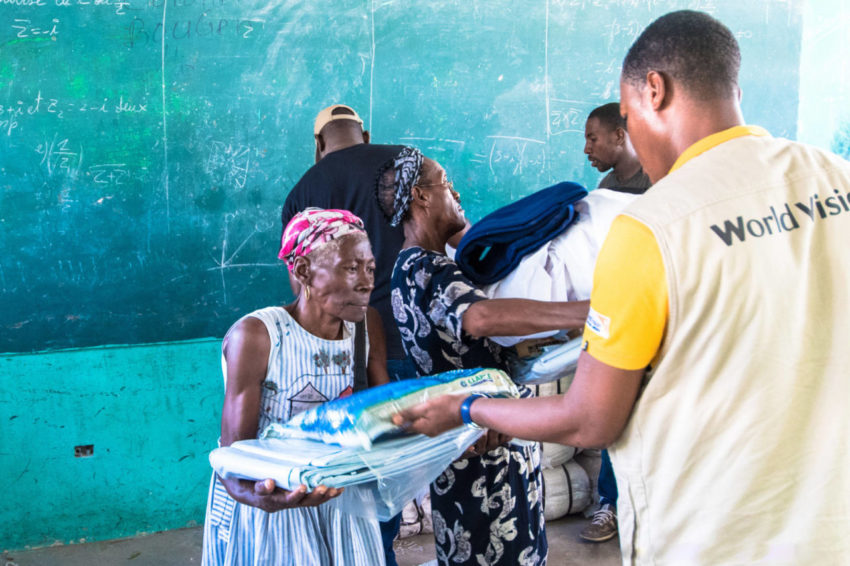 Haiti, after Hurricane Matthew - As soon as the Miragoâne area was accessible by road, World Vision staff distributed goods to 300 families that included blankets, bed sheets, water purification kits, and bed nets to prevent malaria. (©2016 Guy Vital-Herne/World Vision)
