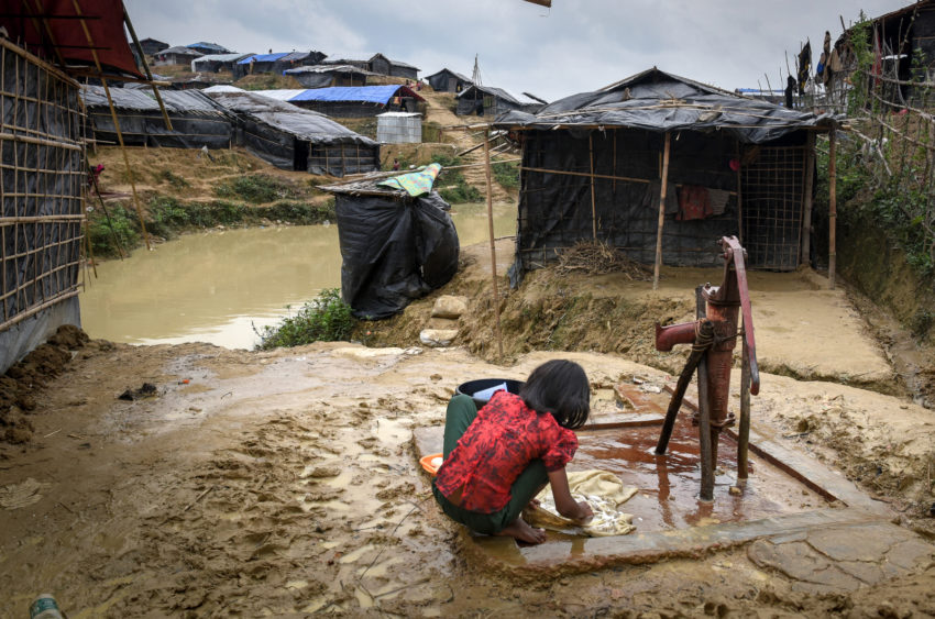 Myanmar refugees in Bangladesh. A young girl washes clothes for her family in a Bangladesh refugee camp. Without access to education and other opportunities, girls are at greater risk of early marriage. (©2018 World Vision/photo by Annila Harris)