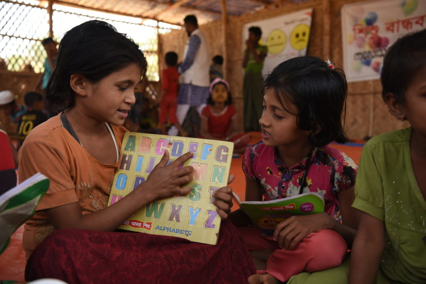 Myanmar refugees in Bangladesh. Children learn alphabet in a Child-Friendly Space. (©2018 World Vision/photo by Annila Harris)