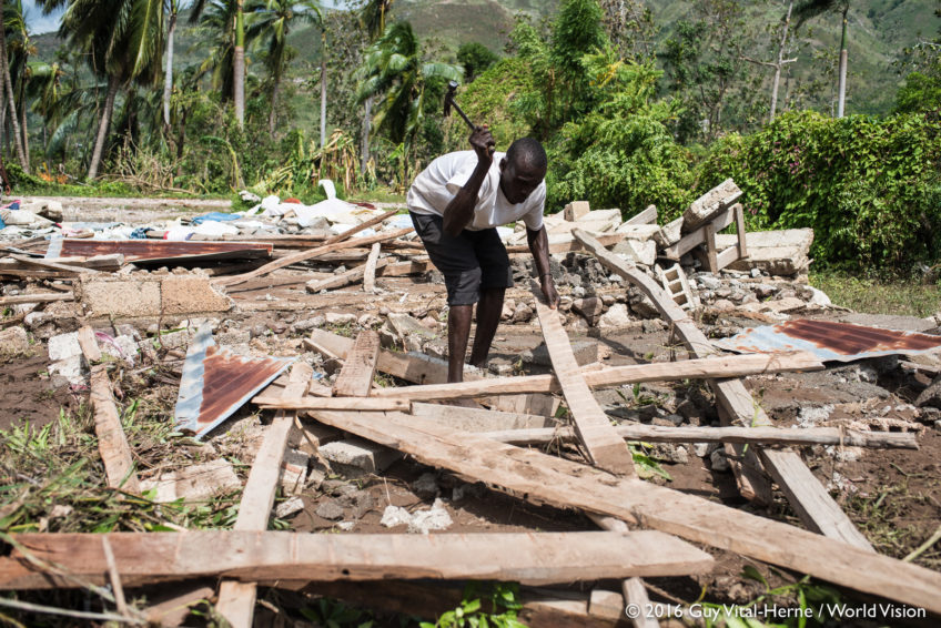 Salvaging timbers from a fallen church, Yves, a church member, begins the slow rebuilding process in Saint Louis du Sud, on the southwest coast of Haiti. The full scale of losses from Hurricane Matthew is still unfolding in some of the hardest-hit areas. (©2016 Guy Vital-Herne/World Vision)